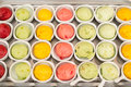 Icecreams top view of colorful balls aligned in small dishes Stock Photos