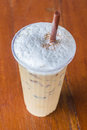 Iced blended cappuccino on wood table Stock Photography