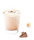 Iced blended frappe coffee on white background with piece of chocolate selective focus Royalty Free Stock Photo