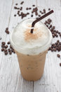 Iced blended frappucino coffee beans on wooden Stock Images
