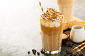 Iced caramel latte coffee in a tall glass Royalty Free Stock Photo