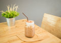 Iced cofee mocha drink serving on wooden table stock photo Royalty Free Stock Image