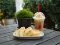 Iced coffee and bakery with cream Stock Images