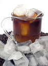 Iced coffee on bed of beans with ice Royalty Free Stock Photography