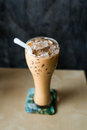 Iced coffee with copyspace composition on table Royalty Free Stock Image