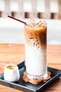 Iced coffee latte with espresso shot adding for Stock Photography