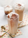 Iced coffee with whipped cream selective focus Stock Images