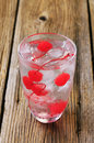 Iced drink with maraschino cherries Royalty Free Stock Photo