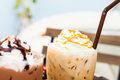 Iced drinks coffee and chocolate with whipping cream Royalty Free Stock Image