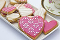 Iced heart shaped cookies teatime with Stock Image