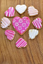 Iced heart shaped cookies on a woodien board Stock Image