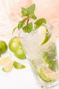 Iced lime mojito cocktail with a straw hat background cuban made cuban rum sugar and splash of soda Royalty Free Stock Photos
