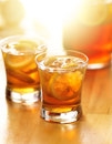 Iced southern sweet tea with lemon slices shot selective focus and sunlight in background Stock Photo
