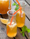 Iced tea in bottle with lemon selective focus Stock Photos