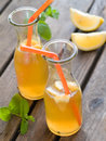 Iced tea in bottle with lemon selective focus Royalty Free Stock Photos