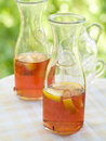 Iced tea in bottle with lemon selective focus Stock Photography
