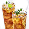 Iced tea close up cold with mint garnish and sliced lemons Royalty Free Stock Photo