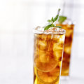 Iced tea close up cold with mint garnish and sliced lemons Royalty Free Stock Photos