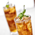 Iced tea close up cold with mint garnish and sliced lemons Royalty Free Stock Image