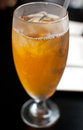 Iced tea in glass with condensation vertical Royalty Free Stock Photography