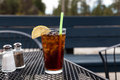 Iced Tea on a Patio Table with Salt and Pepper Shakers Royalty Free Stock Photo