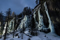 Iced waterfall on mountains shot by night Royalty Free Stock Photo