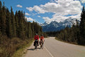 Icefields parkway alberta canada a vacationing couple cycle along the beautiful banff national park Royalty Free Stock Image