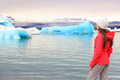 Iceland glacial lagoon woman looking at view of icelandic glacier lake jokulsarlon beautiful young multiracial living Stock Photo