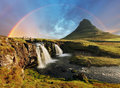 Iceland landscape with waterfall and volcano Stock Photos