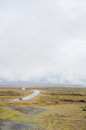 Iceland september fog road in iceland western part mist cloudy road with yellow grass Stock Photography