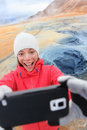 Iceland tourist selfie at mudpot hverir hot spring taking photo with smartphone camera landmark destination namafjall hverarondor Stock Image