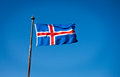 Icelandic flag the civil national of iceland is blue as the sky with a snow white cross and a fiery red cross inside the white Stock Images