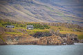 Icelandic landscape houses in foggy mountains horizontal shot Royalty Free Stock Image