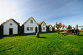 Icelandic turf houses in glaumbae with church at the back Stock Image