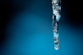 Icicle a single with blue background Stock Images