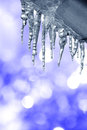 Icicles background with blue lights Royalty Free Stock Image