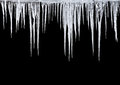 Icicles on a black background Stock Images