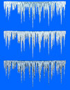 Icicles blue cold with on a blue background Stock Photo