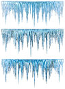 Icicles blue cold with on a blue background Royalty Free Stock Images