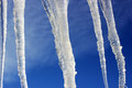 Icicles on the blue sky background Royalty Free Stock Photo