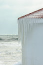 Icicles forming on the roof of a boat shed at beach Stock Photography