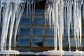 Icicles over window close up of long an old style and broken Royalty Free Stock Image
