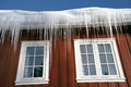 Icicles at a roof of norwegian wintersport house Stock Image