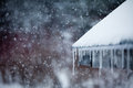 Icicles snowstorm roof Royalty Free Stock Image