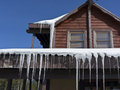 Icicles surrounding a roof Royalty Free Stock Photo