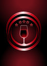 Icon for premier vintage wines with a wine glass full of red wine in two curved concentric circles with a central glow and five Royalty Free Stock Photo