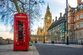 The iconic British old red telephone box with Big Ben, London