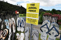 The iconic jandal fence new zealand kaeo nz feb on february in kaeo it s a tribute to that is worn by a Stock Photo