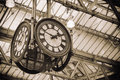 Iconic old clock waterloo station london two of four faces of historic hanging under the glass roof of in england Stock Image