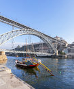 The iconic rabelo boats the traditional port wine transports with ribeira district and dom luis i bridge over douro Stock Image